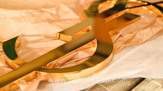 SAINT LAURENT Logo in ottone scatolato dorato